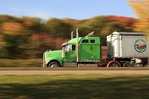 green truck driven by hgv drivers